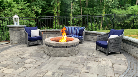 fire pit with patio furniture surrounding the fire pit