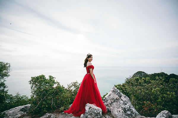 maroon off shoulders crystal belt sash ballgown princess dress on the rocks seaside beach