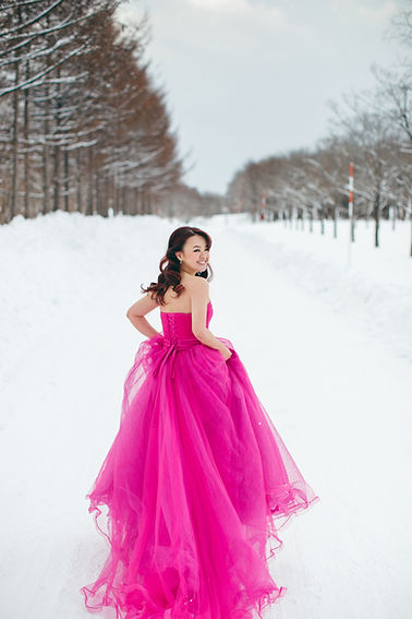 pink ballgown princess dress on a white snow winter destination wedding