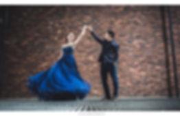 blue sweetheart shimmer glitter ballgown evening dress dancing red brickwall