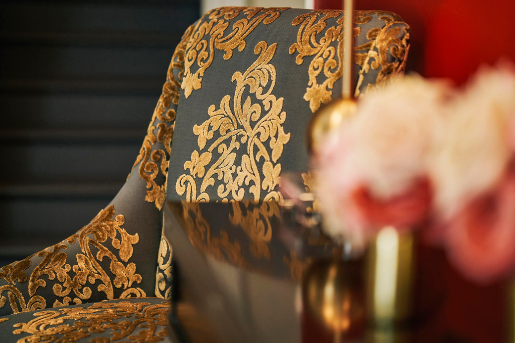 Richly Textured Damask Chairs Welcome Vistors