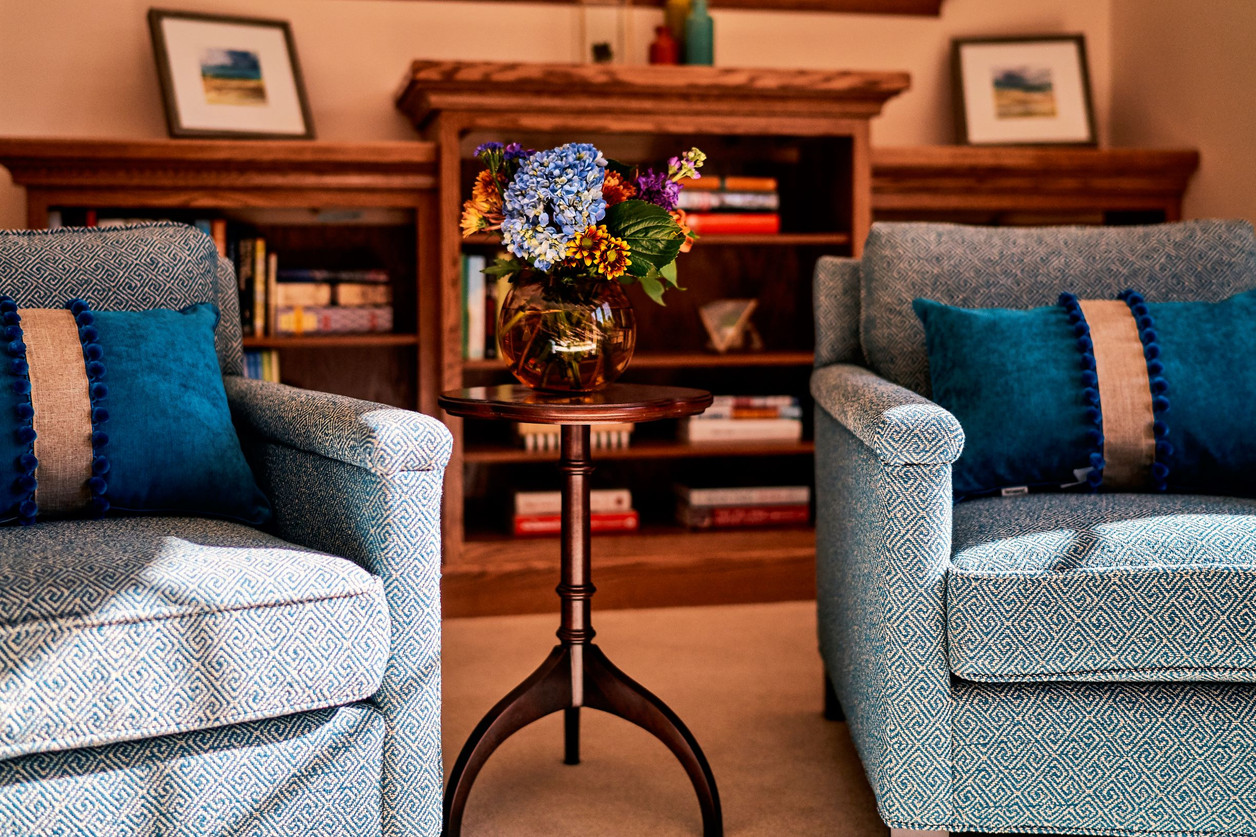 Living Room Club Chairs with Pom Pom Pillows