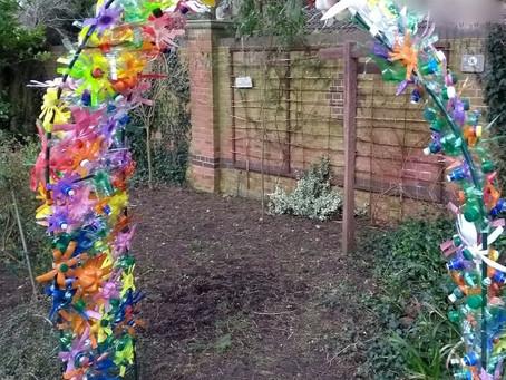Repurposed plastic bottle flower arch