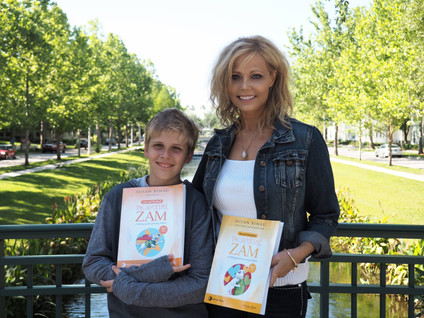 Susan & Andy with ZAM books.jpg