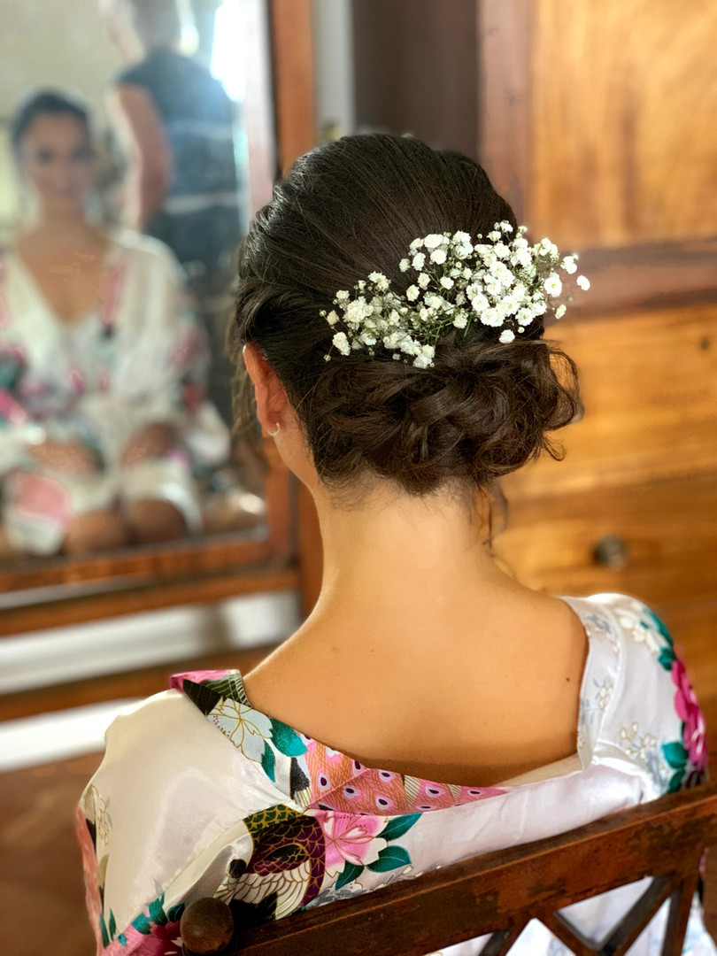 Low, curly bun. Romantic bridesmaid hair. Gypsophilia