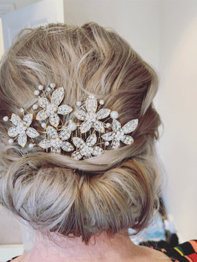 Relaxed, low updo. Mother of the bride hair. Hair jewellery
