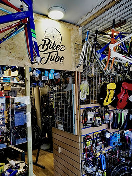 Inside space of the Bikeztube's workshop where the bicycles are fixed and bicycle accessories gloves , bicycle panniers , bicycle locks , bicycle tyres and bicycle frames