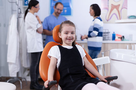 cheerful-kid-sitting-on-chair-in-dentist-office-du-YZ4Z6VT.JPG