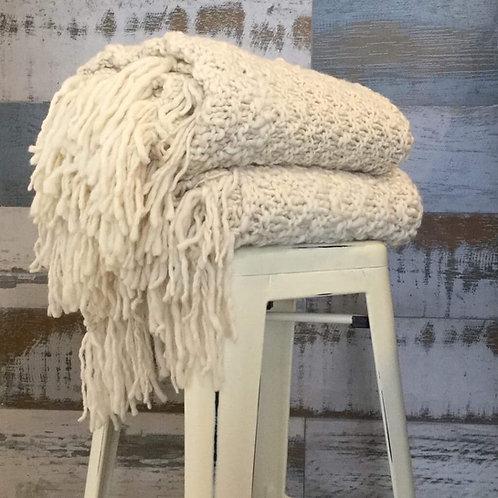 Manta en lana Merino con flecos