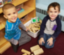two preschool age children learning though play