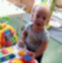 Toddler in daycare playing with learning table