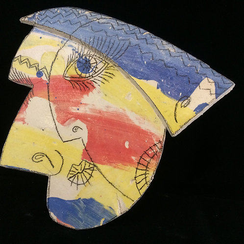 Abstract face ceramic wall piece