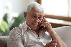 Smiling older man talking on cellphone c