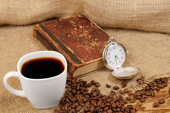 Roasted coffee beans, old book, watch an