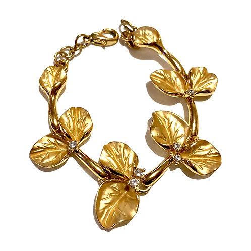 Pulseira dourada com folhas