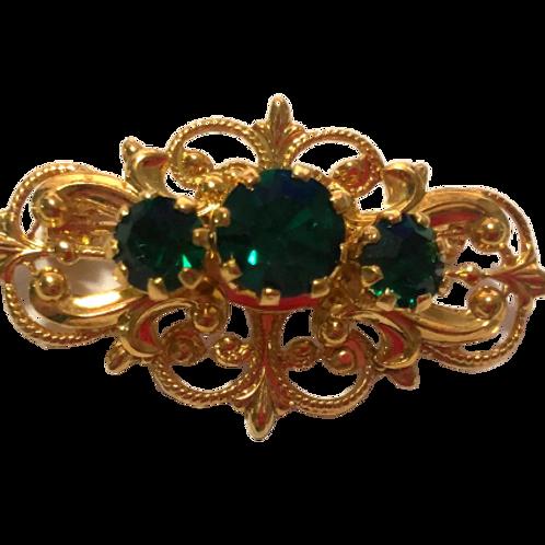 Broche dourado com strass verde