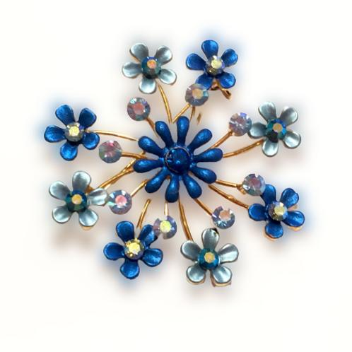 Broche de flores azuis