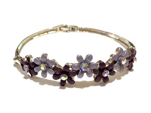 Bracelete prateado com flores
