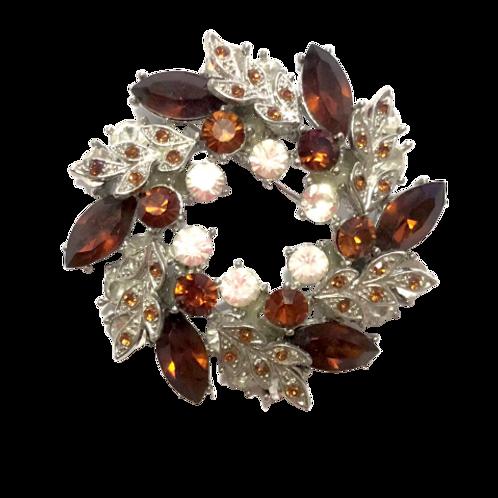 Broche de guirlanda de cristais