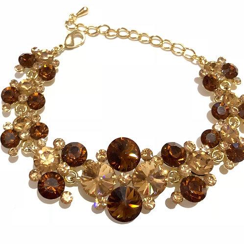 Pulseira  dourada com cristais