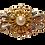 Thumbnail: Broche dourado com pérola