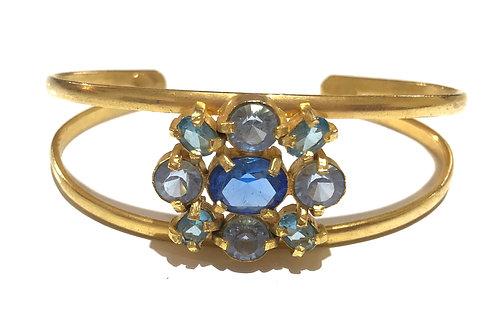 Bracelete dourado com cristais azuis