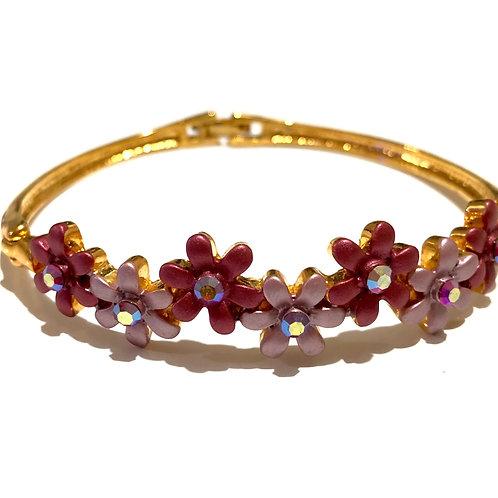Bracelete dourado com flores