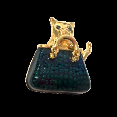 Broche de gato na bolsa
