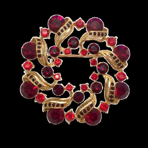 Broche redondo dourado com cristais