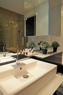Bathroom in apartment golden black