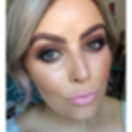 Makeup by Kristi wearing a brown smoky eye and nude lip combo