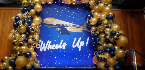 Aviation Inspired Backdrop with Custom Balloons!