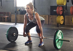 Woman setting up for a clean and jerk