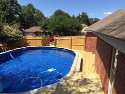 custom pool deck that encompasses the whole back yard