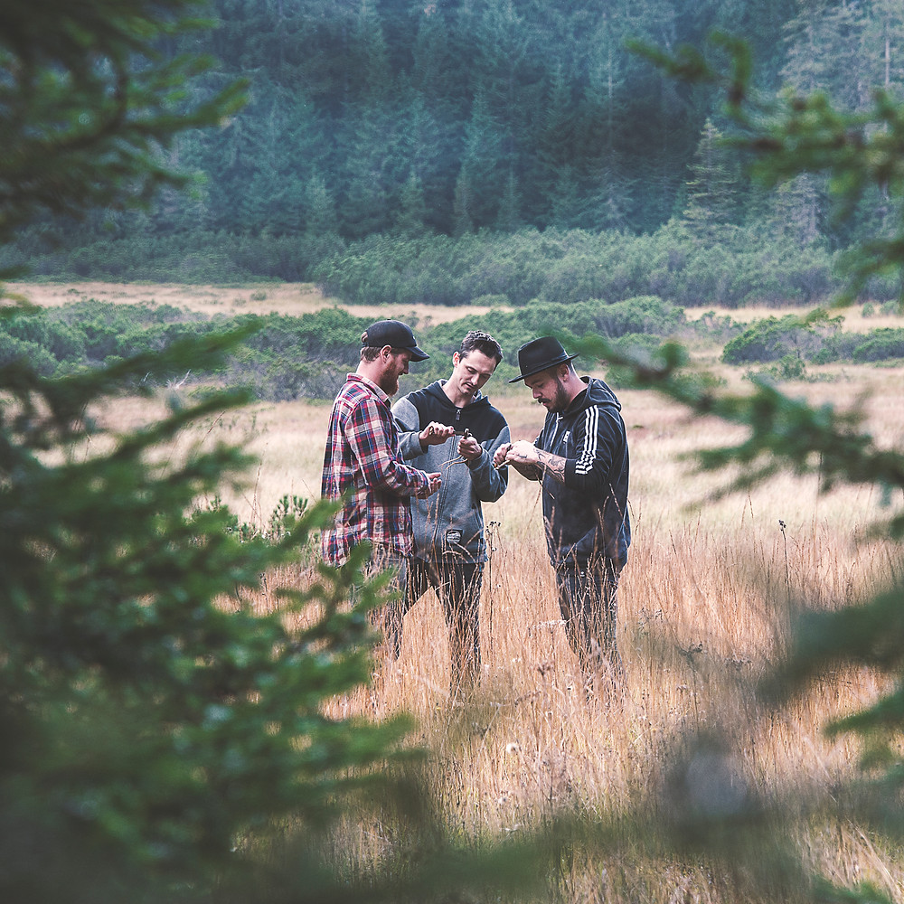 3 guys from Karakter Distillery in the middle of the forest