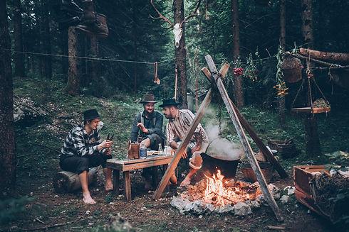 Three friends from Karakter Distillery sitting next to improvised still in the Pokljuka forest.jpg