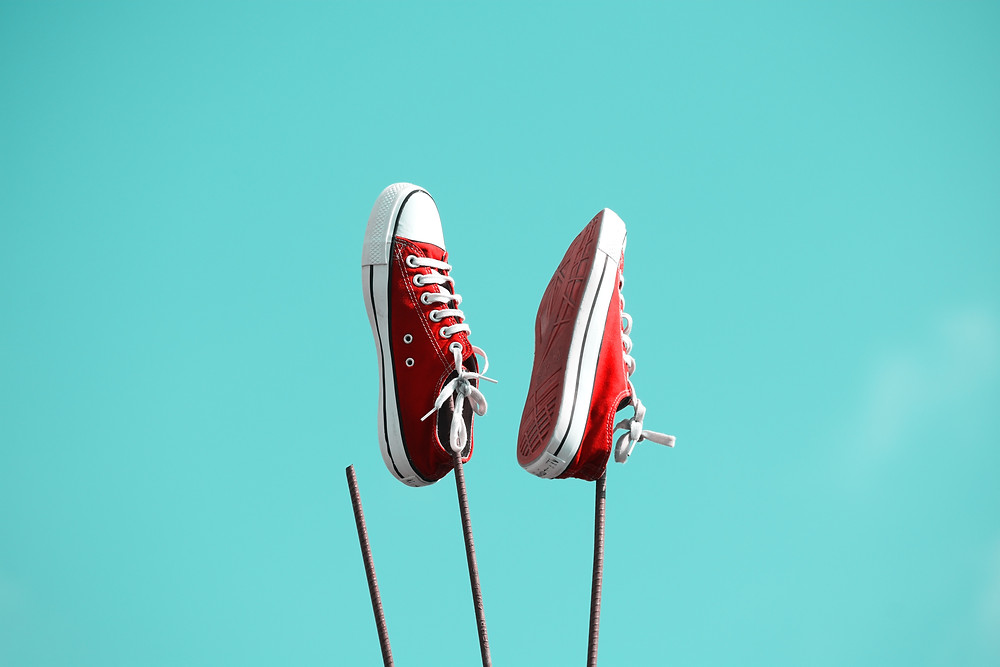 Close up of a pair of red chucks trainers