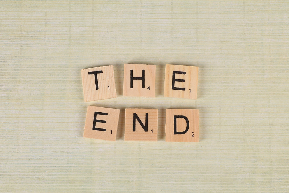 scrabble tiles spelling out 'the end'