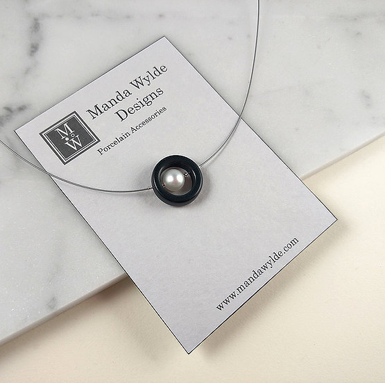 Timeless Elegance Single Pearl Necklace in Black