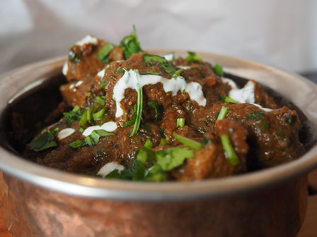 Simon Majumdar's Lamb Curry topped wth cilantro and a drizzle of yogurt