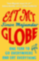 """Eat My Globe"" by Simon Majumdar softcover with title and a fork with an animal"