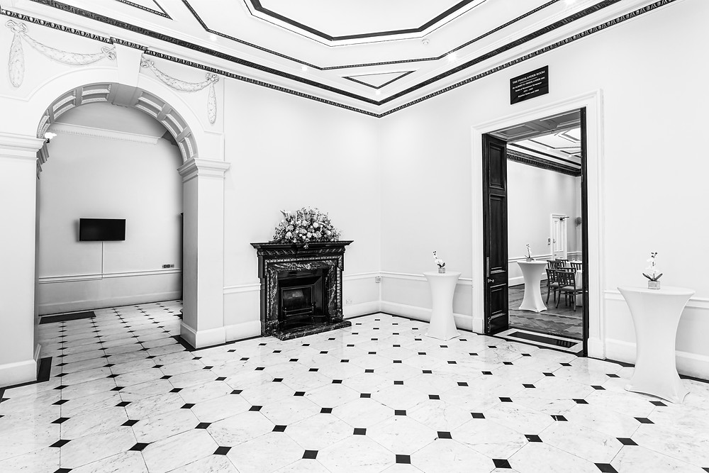 Inside Kent House, marble floors, archway and fireplace