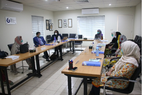 Image of field staff being trained at the HDRF office in Pakistan.
