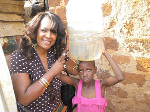 Child carrying water.JPG.jpg