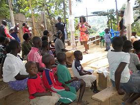 Speaking in the Village.JPG