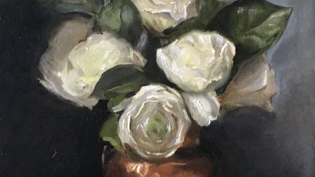White roses in a copper pot