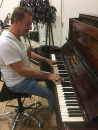 playing John Lennon's piano...