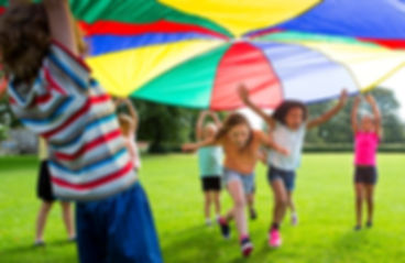 kids-playing-with-parachute.jpg