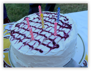 Happy Birthday Cake: Yellow Cake with Raspberry Filling and Whippy Cream Frosting