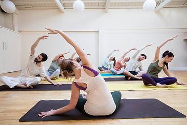 Woman Teaching Yoga to Students